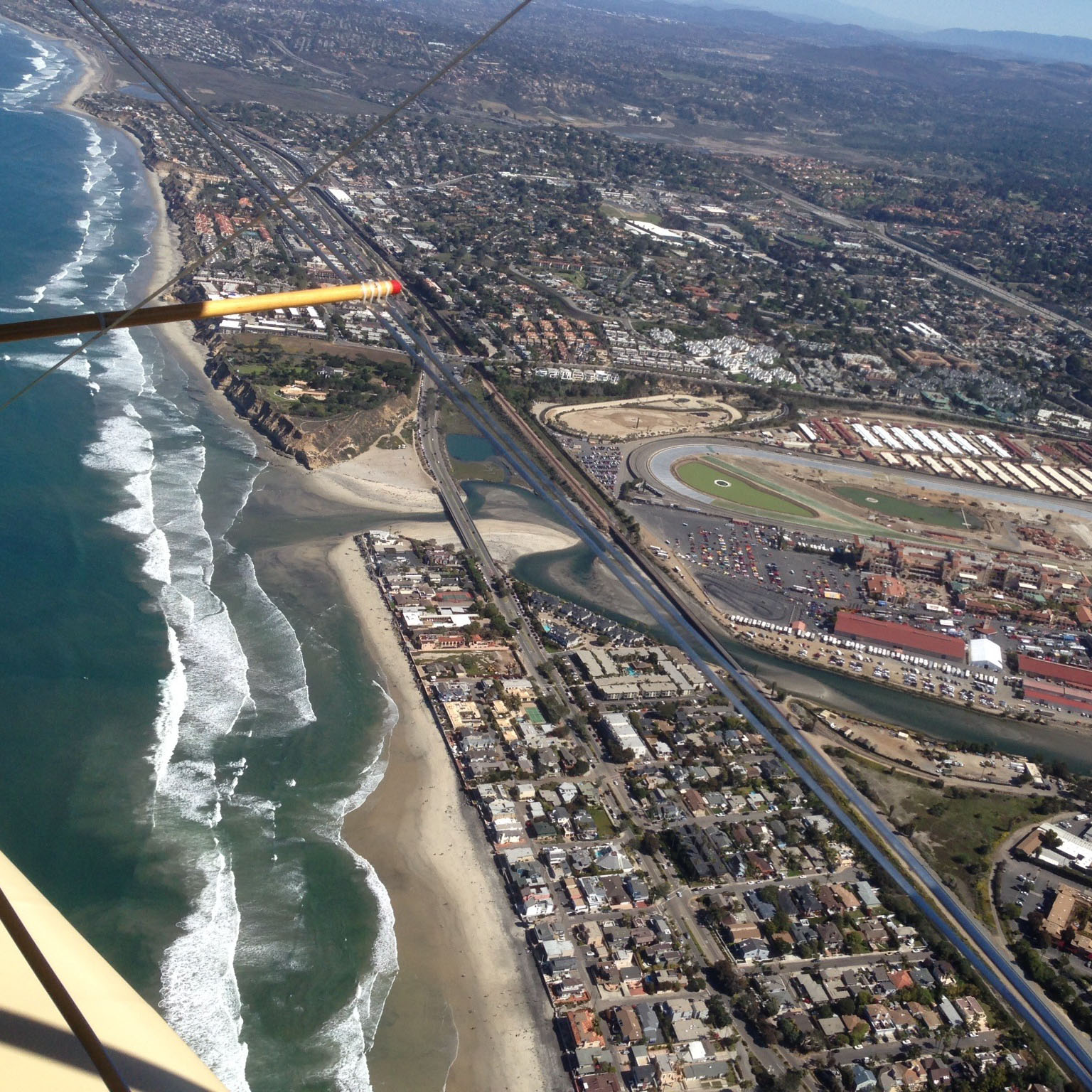 Fun Flights biplane rides over the coast and beach from